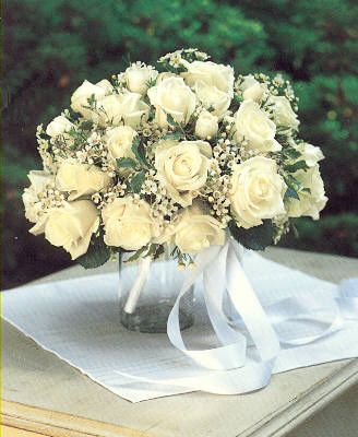 Item  White Roses and Wax flower bouquet.