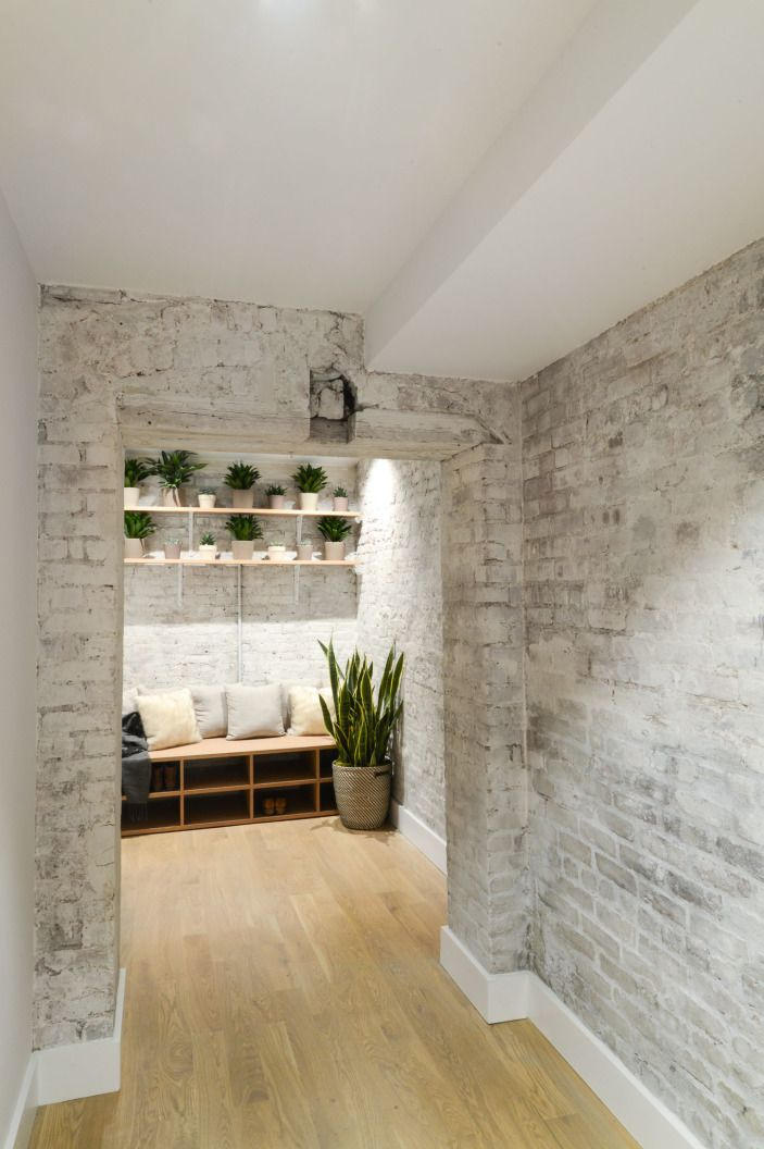The white-washed brick continues through the space as do the little touches of greenery, imparting a sense of calm from the beginning to the end of your meditation.