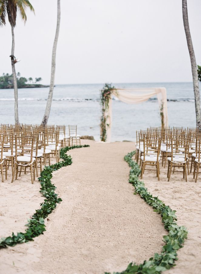 If you're under the impression that ballgowns and beach weddings don't mix, this wedding will come as a pleasant surprise. The bride, Ashleigh wore her dream Lazaro dress for their toes-in-the-sand ceremony and Carrie King made magic happen behind the