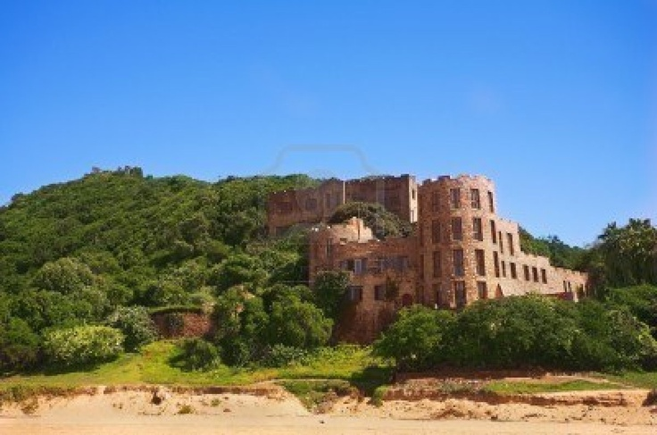 The Castles at Noetzie beach and reservation area in the Eastern Cape, South Africa. A newer castle is in the foreground with one of the old castles in the background (further up the hill) Stock Photo