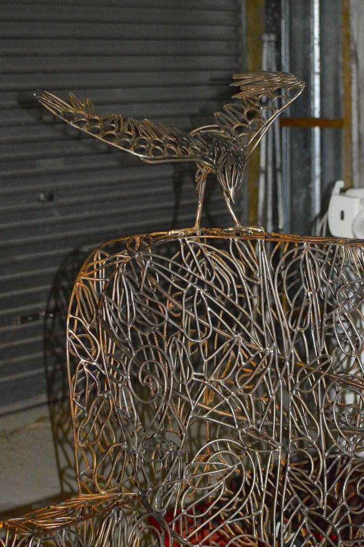 New Zealand Falcon on Chaise Lounge. Two steel sculptures by Sharon Earl.  www.sharonearl.com Twitter @weldagirl Instagram sculptor.sharonearl