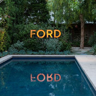 This one caught my eye since my family members have this last name. It would look so fun by my brother's pool! Hmmm, where to find a spare Ford sign?