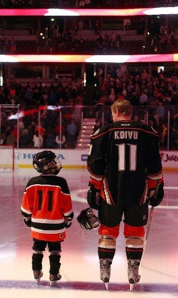 Saku Koivu and son before the Oilers-Ducks game  4-8-13