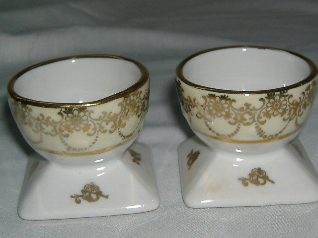A pair of china egg cups made in Limoges, France, in the early 20th century