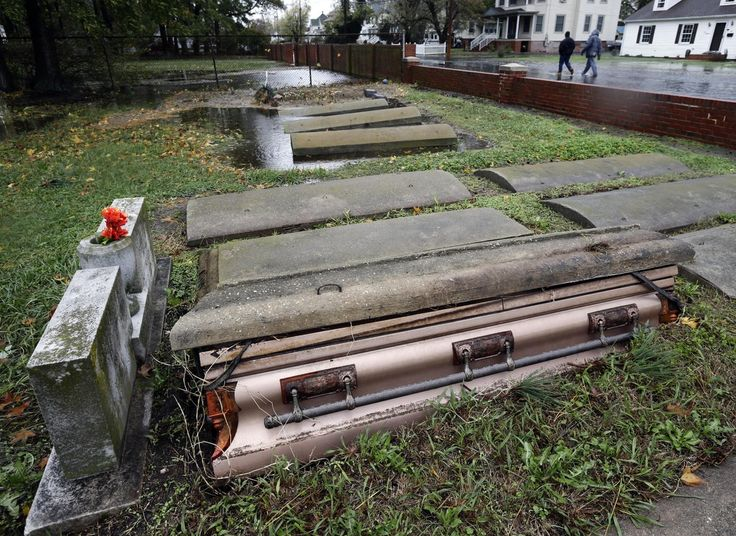 A casket floated out of the grave in a cemetery in Crisfield, Md. after the effects of superstorm Sandy Tuesday, Oct. 30, 2012.