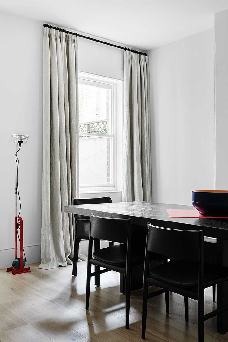 An old Victorian in East Melbourne has been transformed with an elegant and sophisticated design from Flack Studio | Black and gray modern dining room decor