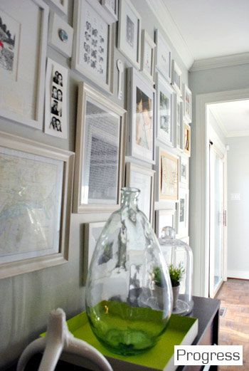 May do something like this in the downstairs hall or on the landing with black frames. From the blog Younghouselove.