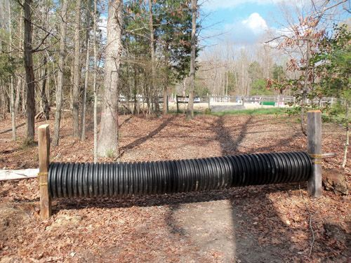 GREAT culvert jump idea! Put it over a pole, nail pole to posts, there you go!