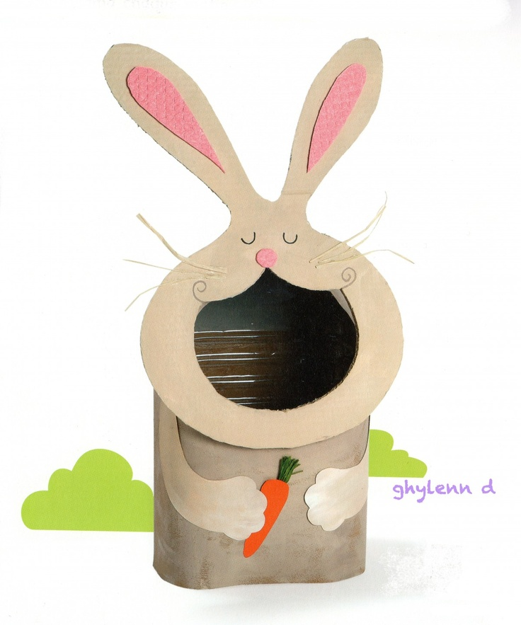 A Rabbit Can - Cute!  Glue felt-covered cardboard head onto cut-away can.  Paint on hands and carrot directly onto can, or paint on paper/fabric that is attached to can.  Use white pom-poms to toss for a game.