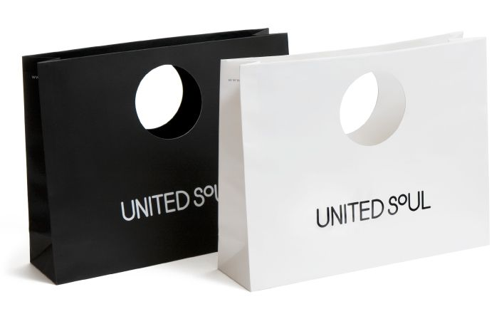 Carry bags for clothing store United Soul using a glossy coated ...