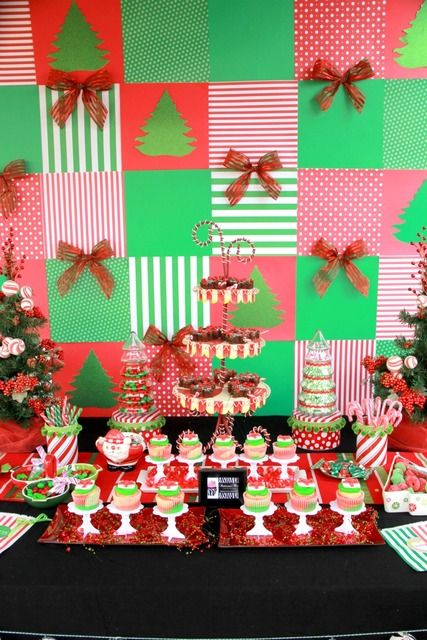 Holiday backdrop.  This would be so easy to do with scrapbook paper and foam board!  I great inexpensive way to decorate behind a food table or bar!