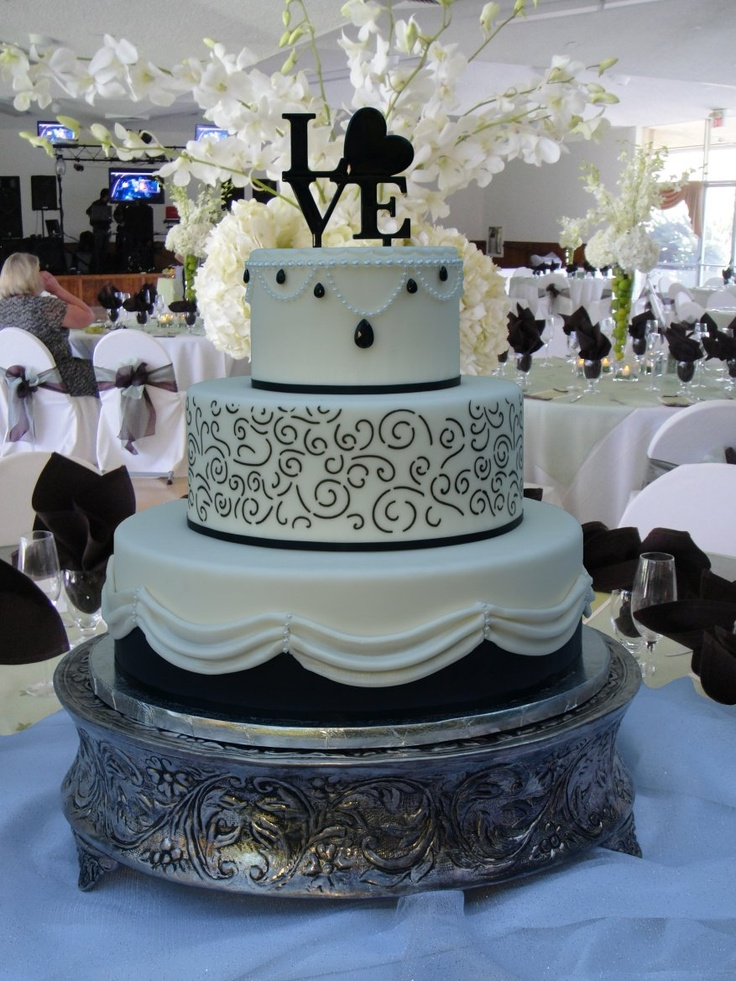 Black Diamond wedding cake, black and white rolled fondant, jewels, glitz, pearls, scrolls and drapes  www.cakedesigners.net