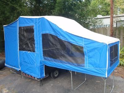 2005 Time Out Motorcycle Camper Camping Trailer (this photo is for example only; please contact seller for pics of the actual motorcycle camping trailer for sale in this classified) The Time Out Motorcycle Camper for Sale is a pop-up camper with a spare tire, cooler, new heavy duty zipper on the door.  Every zipper works and it's in