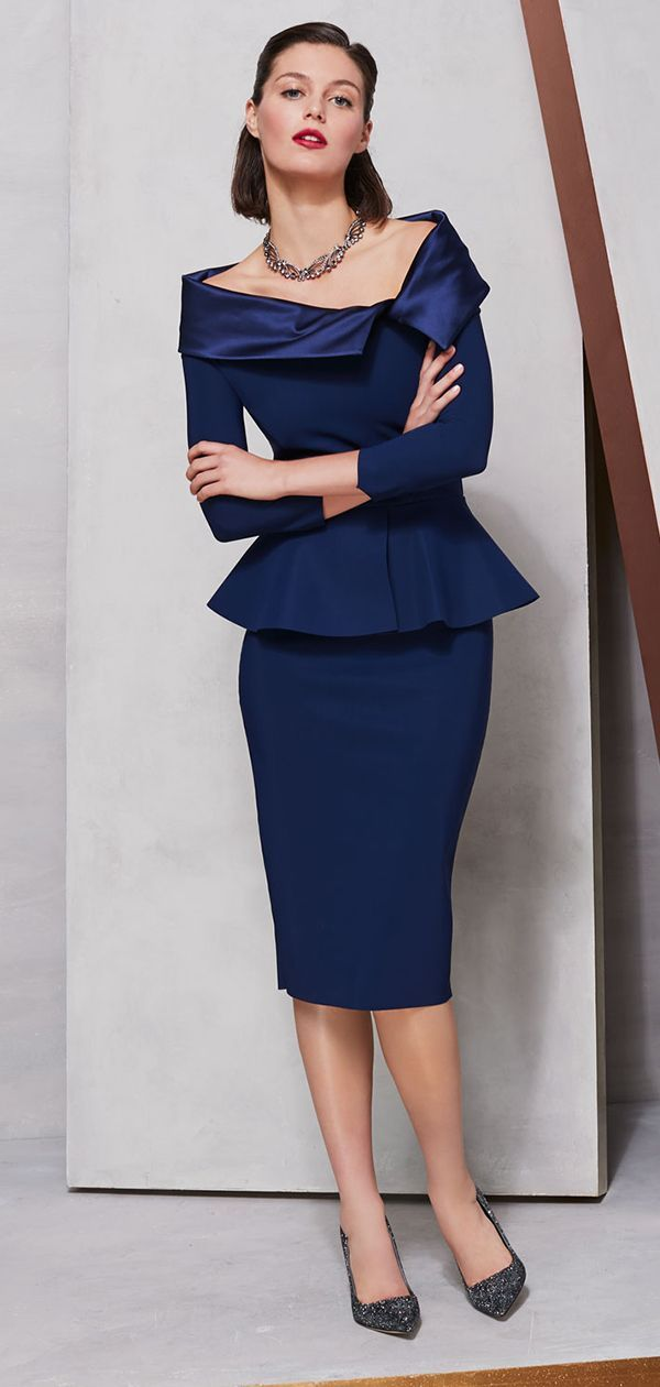 a801ccd7 This statement cocktail dress has an asymmetric neckline, three-quarter  sleeves, and body-conscious silhouette. #cocktaildress #partydress