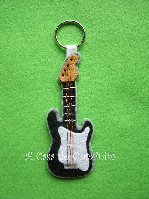 Felt guitar on a keychain....<3. Use milk jug plastic to make it firm...