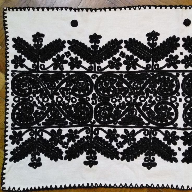Embroidered in black cotton on a pale home loomed fabric This wall hanging was probably made between the world wars