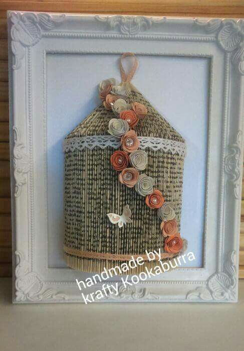 Framed bookfold birdcage decorated with handmade paper roses and finished with pearls and gems.