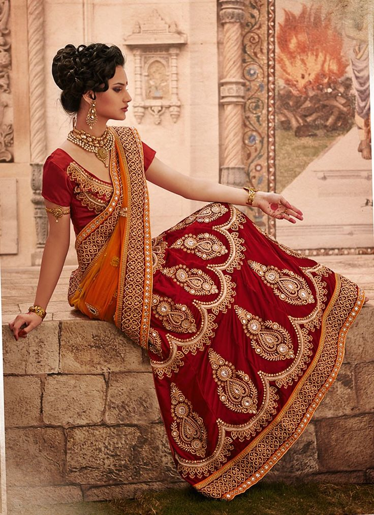 Shop this product from here.. http://www.silkmuseumsurat.in/maroon-stone-enhanced-velvet-lehenga-choli?filter_name=4635  Item :#4635  Color : Maroon Fabric : Velvet Occasion : Bridal, Party, Reception, Wedding Style : A Line Lehenga Work : Applique, Embroidered, Patch Border, Resham