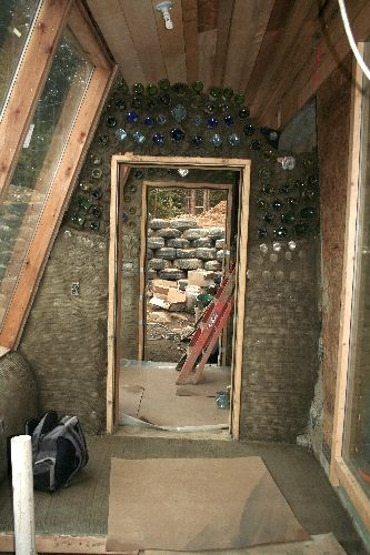 West Wing Airlock bottle wall doorway of Main House Earthship, image by Monica Holy