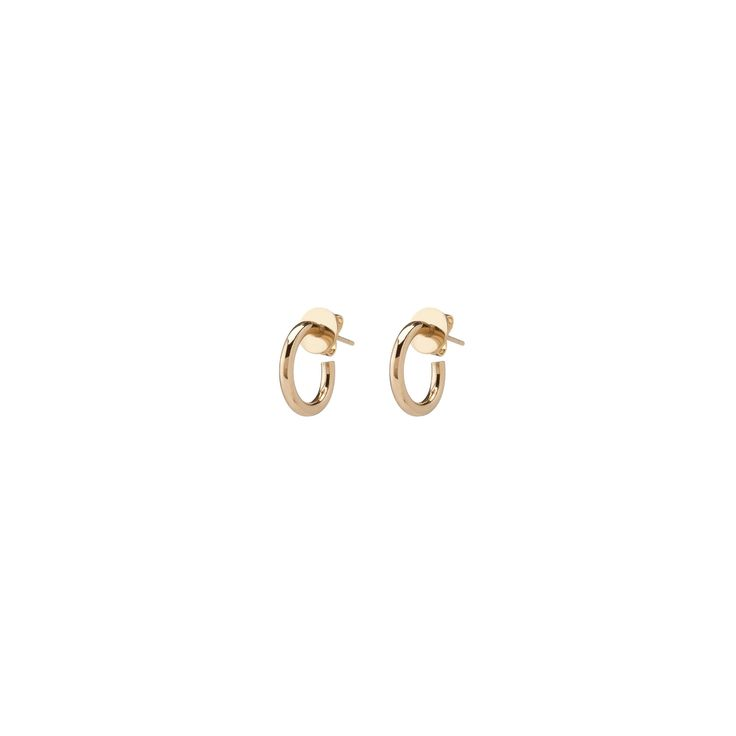 """Solid 1/2"""" hoop earrings made from 14k gold. These hoops are the smallest of our Eternity Hoop collection. Wear alone, together or mixed and matched. This style is also available in 2"""".   14K gold Available in yellow, white or rose gold 1/2 inch diame"""