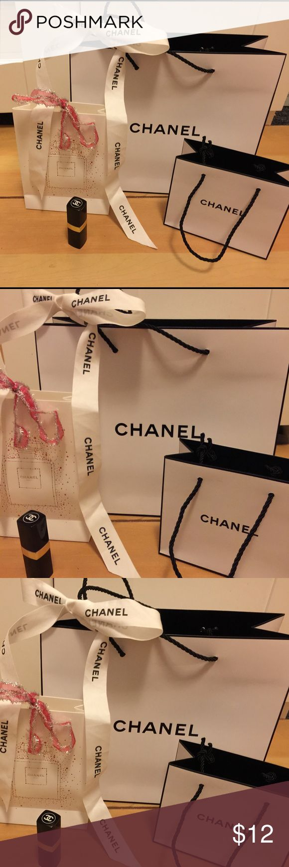 Bundle 3 Chanel Shopping bags Bundle of 3 Chanel shopping bags plus ribbon, the lipstick is not on sale I just put it there so you have an idea how big the bags are CHANEL Bags