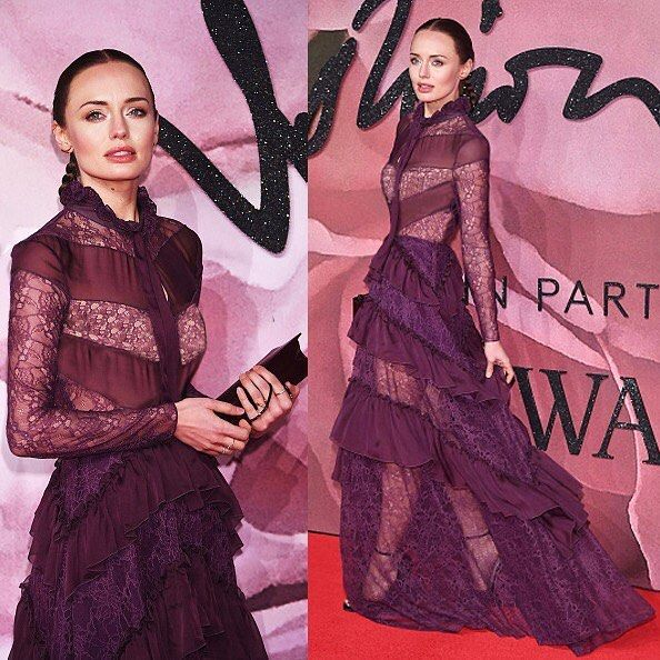 Actress @laurajhaddock stopped #TheFashionAwards red carpet in its track yesterday night as she arrived wearing a long sleeve plum gown rendered in sheer lace, featuring a ruffled neck with a bow, a tonal chevron design at the bodice & a floor sweeping skirt with Chevron tiers of ruffles throughout #Pf16 #zuhairmurad #transformers