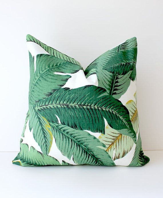 Brand new pillow cover in a bold swaying palm leaves floral print.  The fabric features various shades of green on top of an ivory background. Palm