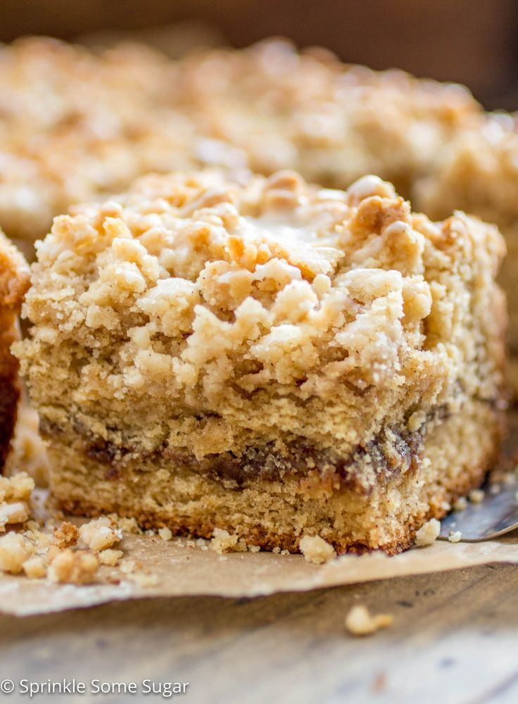 Soft lightly spiced coffee cake is filled with a gooey cinnamon swirl center and topped with a sweet streusel topping + vanilla glaze!