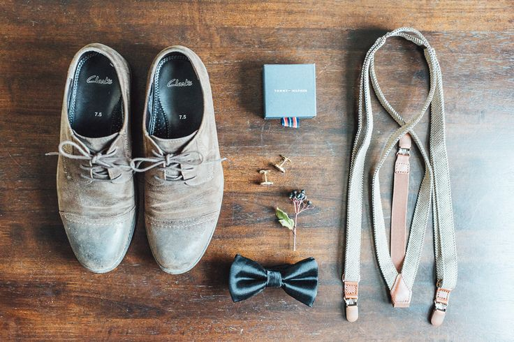 Grooms wedding attire. Rustic simple elegant. Black tie and brown suspenders. Tuscan wedding. Nicole and Steven Photography.