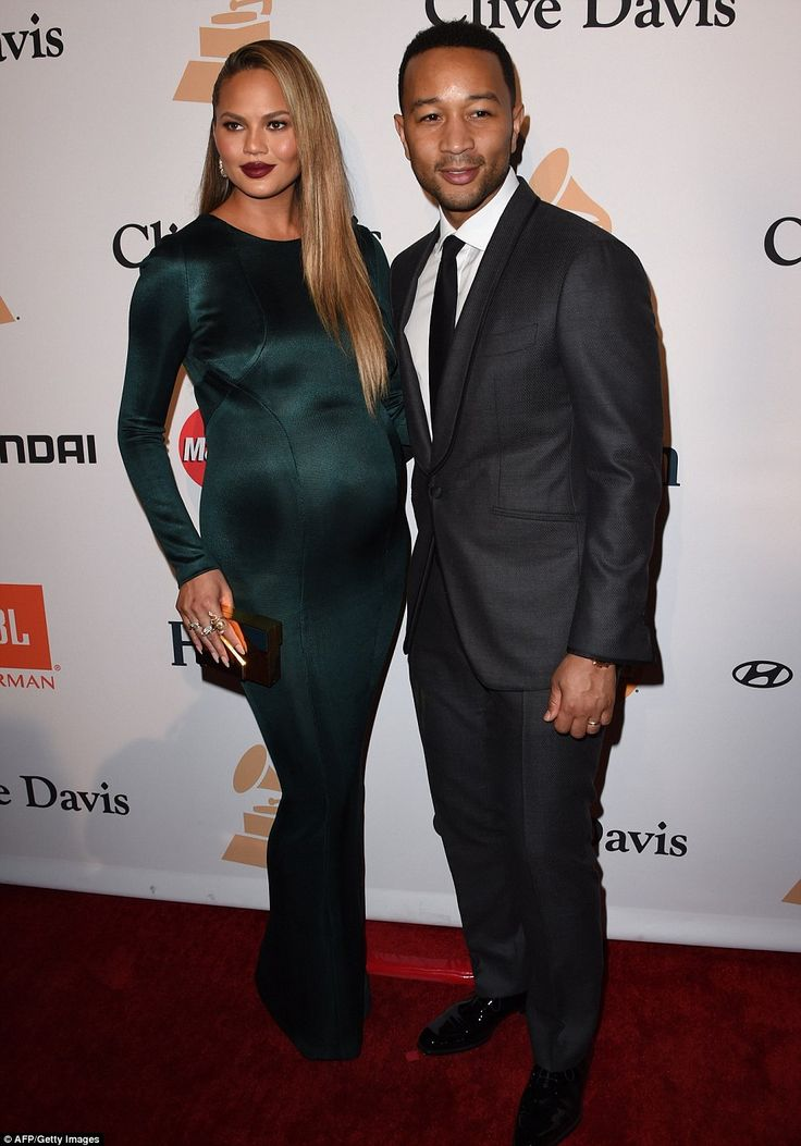 Stylish mother-to-be! Chrissy Teigen stunned in a green figure-hugging gown as she arrived to the Clive Davis pre-Grammy gala with husband John Legend
