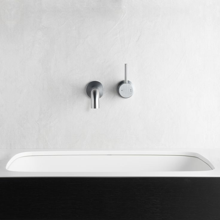 Brushed Chrome is a subtle finish with a cool neutral tone. Pictured: 30654-55 Pegasi M Wall Basin Mixer Set 150  #faucetstrommen #faucet #tapware #bathroom #design #architectural #brushedchrome #pegasi #moderntaps #basinmixer #customfinish #bathroomdesign #builtinaustralia