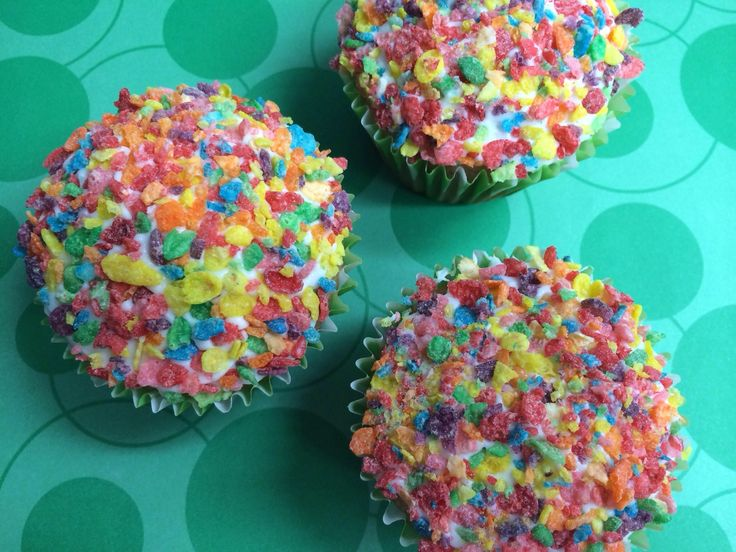 These cupcakes are LOADED with fruity pebbles! I added 2 cups of crushed fruity pebbles to a box of white cake mix. (And by crushed I mean powder-ized.) I spread a thin layer of my Easy Buttercream...