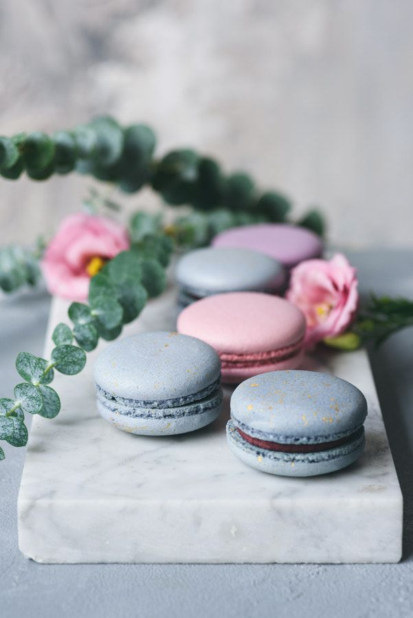 Pastel macaroons or macarons and flowers on marble by Vladislav Nosick - Photo 236206291 / 500px