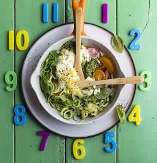 """This recipe makes for a quick courgetti """"pasta"""". We used a Chinese slicer for the noodles, which makes them feel authentic and really speeds up the process. If your kids aren't into basil pesto, try a gentler tomato pesto instead."""