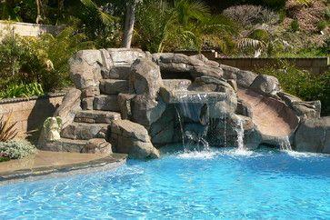 Waterfall swimming pool with rock slide