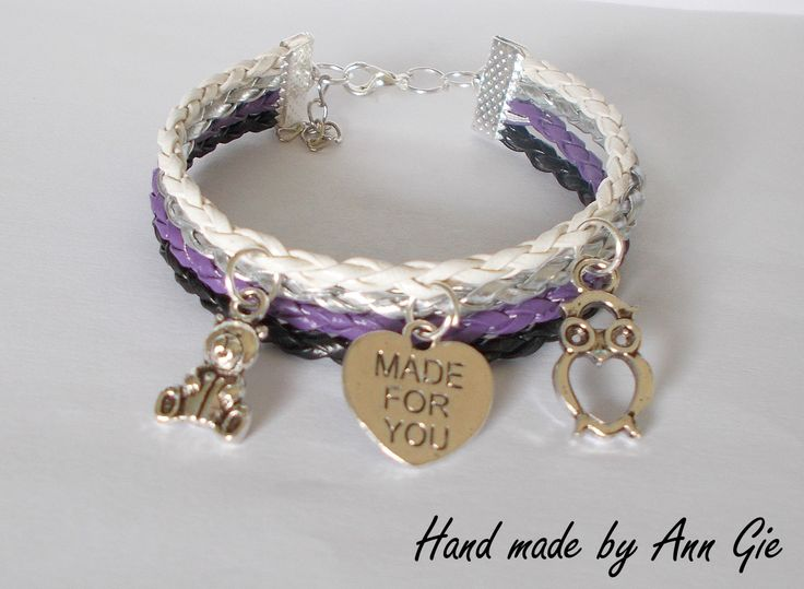 White, silver, violet and black bracelet with charms