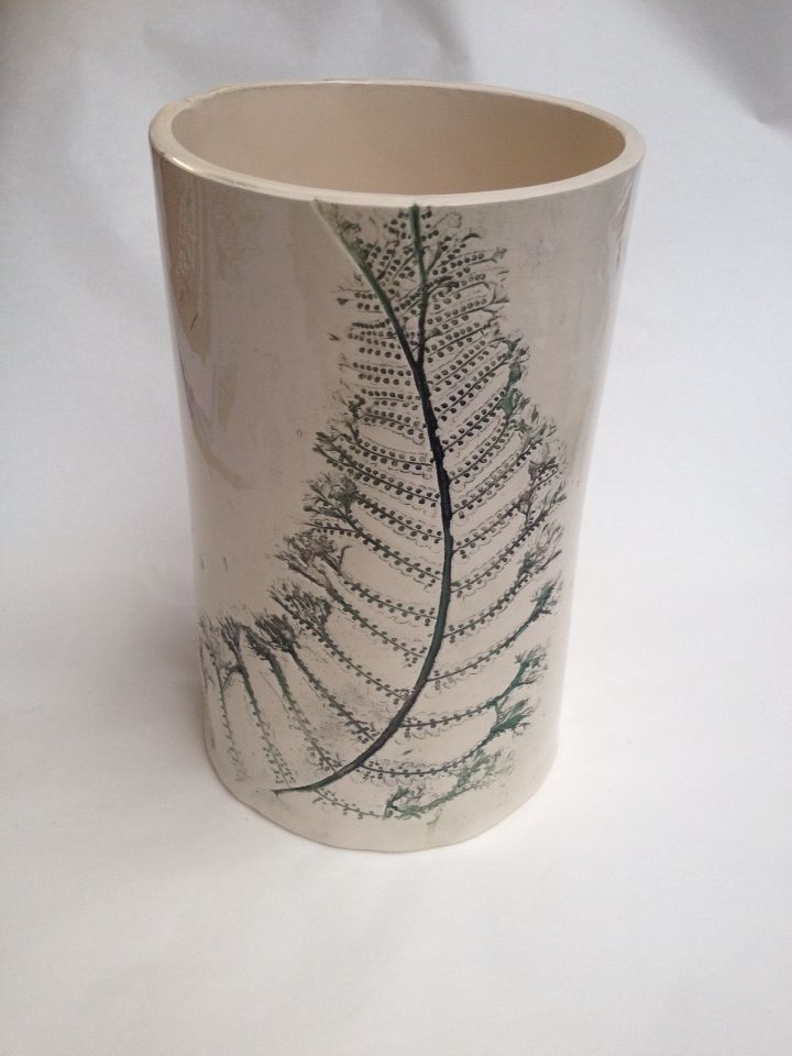 Handmade ceramic vase with botanical fern surface decoration. Embossed surface to highlight the detail of the leaf. Tube pot vase with tonal fern pattern. Handmade by Gabrielle Turner.