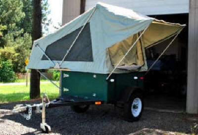 M.O.A.B folding tent unit.  I might just have to build my own lightweight camping trailer.