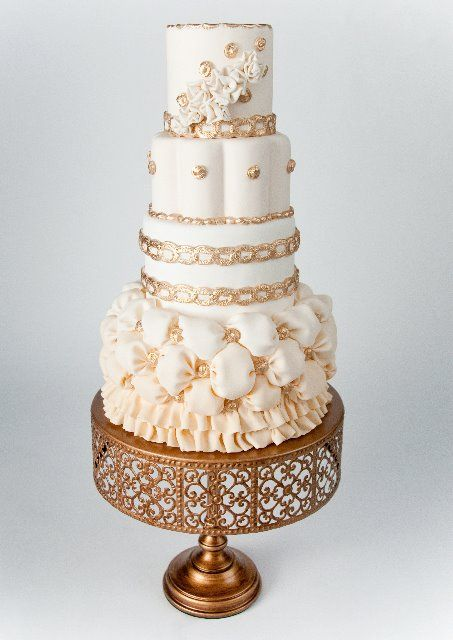 White and gold wedding cake... love the pillowed effect.