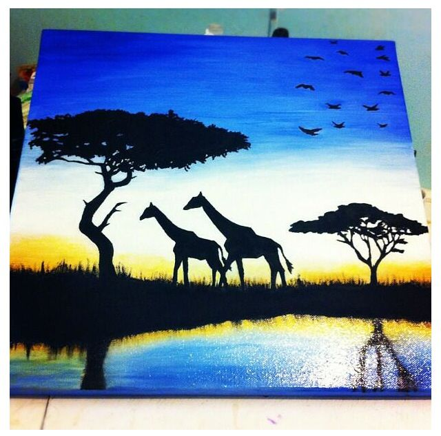 Painting of giraffe silhouettes on the African plain