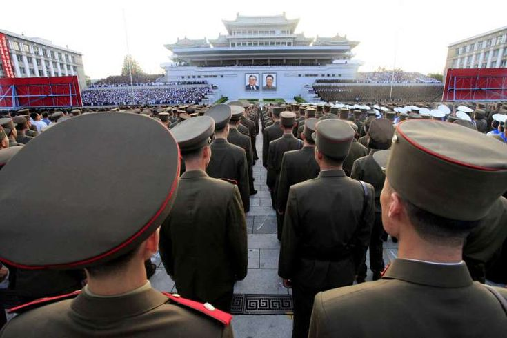 Military personnel stand during a rally at Kim Il Sung Square July 2, 2016, in Pyongyang. They were celebrating the new title of chairman of the new State Affairs Commission given to leader Kim Jong Un at a meeting of its national parliament.