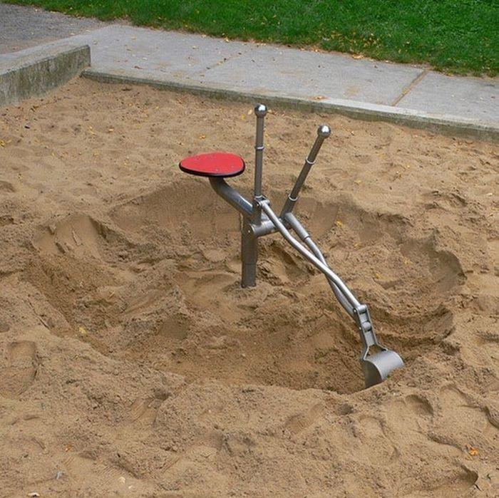 Pelleteuse dans le bac à sable