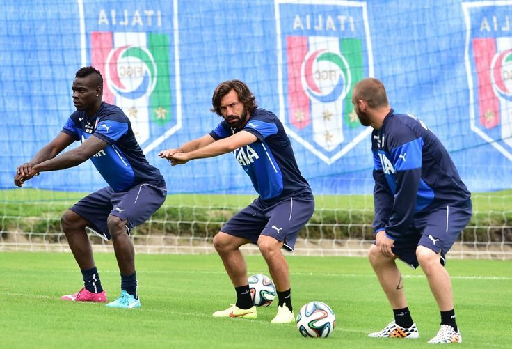 World Cup 2014: Pictures Of The Day Thursday 12th June 2014 - Italy's forward Mario Balotelli, midfielder Andrea Pirlo and midfielder Daniele De Rossi stretch during a training session at the Portobello Resort in Mangaratiba on June 11, 2014 ahead of the 2014 FIFA World Cup football tournament in Brazil.