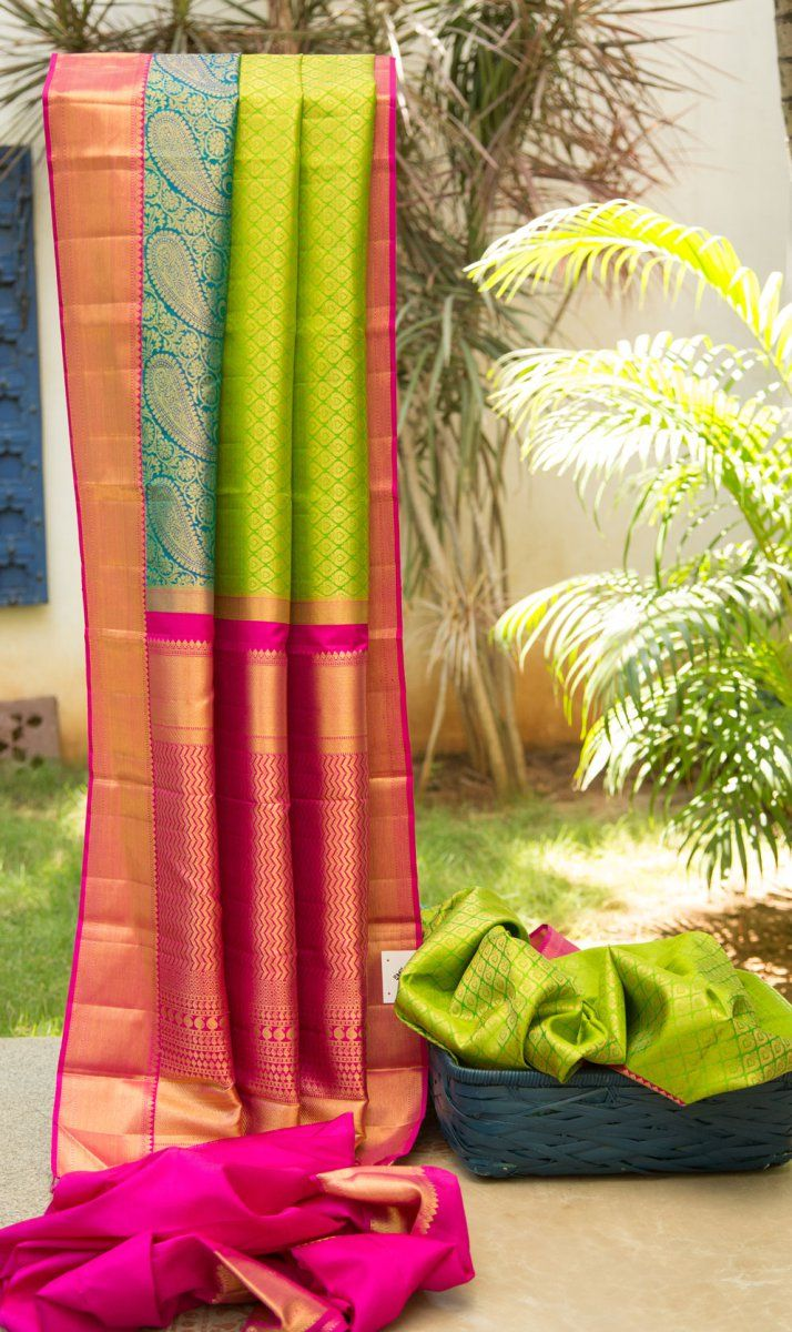 Colours combine beautifully to bring this kanchivaram to life. The multi coloured border with paisley inspired motifs woven in makes this piece unique