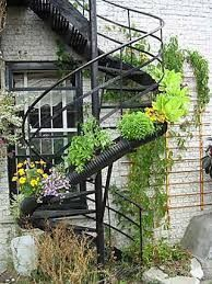 Another revision, instead of having a fire escape, a spiral staircase would mean interesting blocking options and could even have the vines climbing up it.