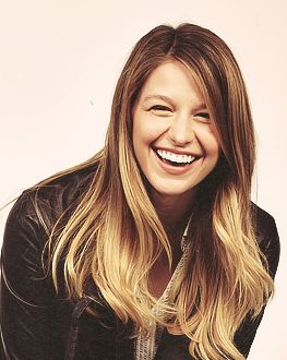 "{ Melissa Benoist } ""Hi."" I smile ""I'm Melissa but you can call me Mel. I am 20 and single. I was on the show glee. I have a crush on one of my co-stars but I doubt he would ever like me back. I love singing and being around people. I am always ready to break out in song! Anyway come and introduce!"" I smile"