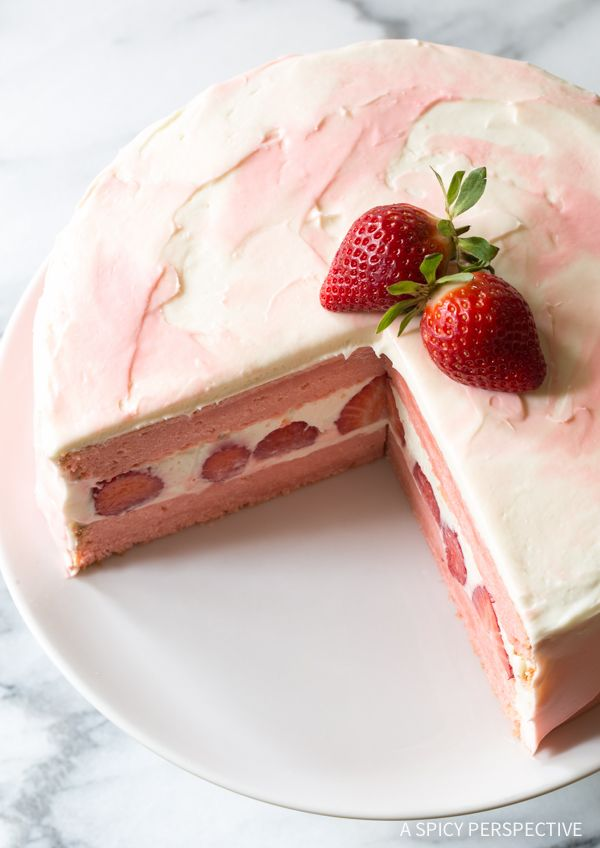 Fresh Strawberry Lemonade Cake Recipe - A moist tender layer cake with fresh strawberries hiding in the middle. Topped with lemon cream cheese frosting!