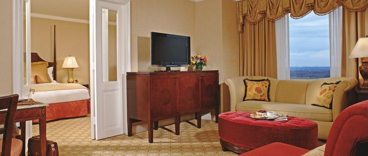 Upgrade to the beautifully sophisticated Executive Suite with living and bedroom areas separated by French doors at The Ritz-Carlton, Tysons Corner.