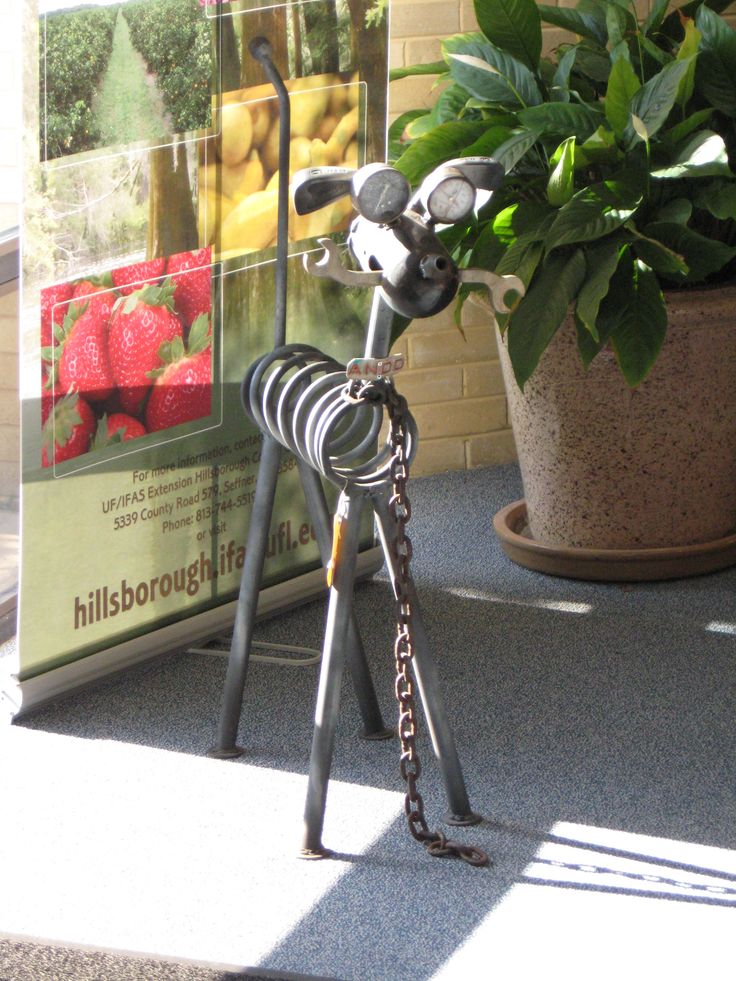 2013 Recycled Yard Art Contest Winners: People's Choice Award - Andy Hamilton for his Junkyard Dog sculpture created with a chain, spring, golf clubs, pressure gauges, a tire iron and wrench.  http://hillsborough.ifas.ufl.edu/   #reduce #reuse #recycle