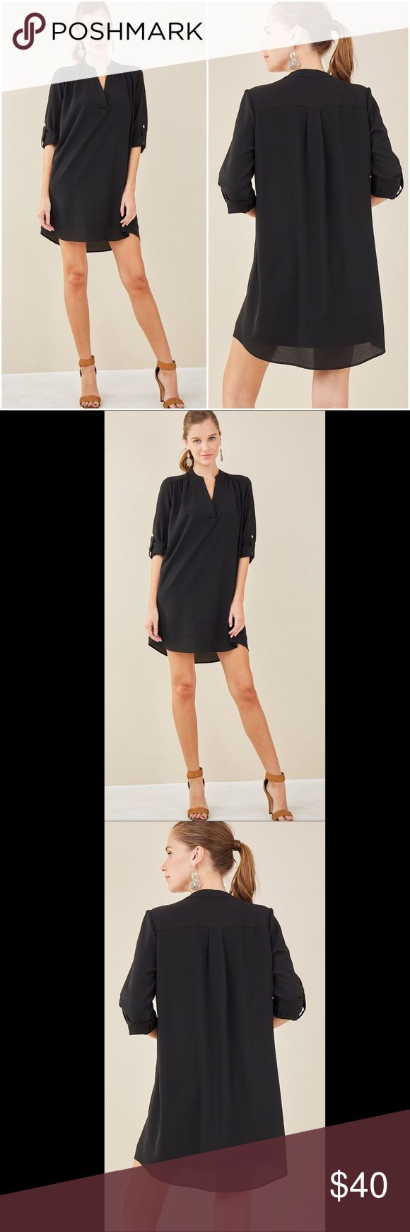 ✨🆕✨V-Neck Dress with Roll-Up Sleeves - Black V-Neck Dress with Roll-Up Sleeves - Black stretchy knit lining - Made in USA - Black non-stretchy woven self - 3/4 roll-up sleeves - V neckline - Self: 100% polyester   NOTE: dry clean or hand wash cold, do not bleach, hang/line dry. Dresses